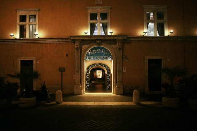 The entrance to the Hotel Columbus at night (photo courtesy of Hotel Columbus).