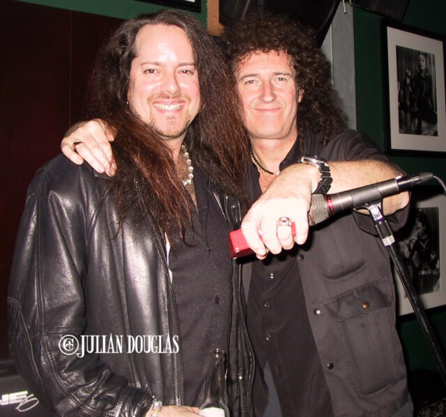 On stage with Queen's Brian May back in January, 2002.