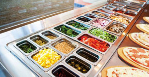 A hot of just some of the toppings available. Photo courtesy of Pizza Rev.