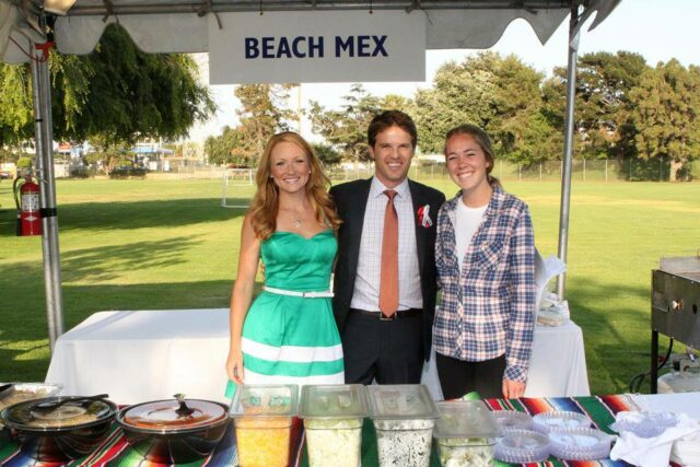 Kinmberly on the left & Scot in the middle as Beach Mex caters an event (photo courtesy of Beach Mex).