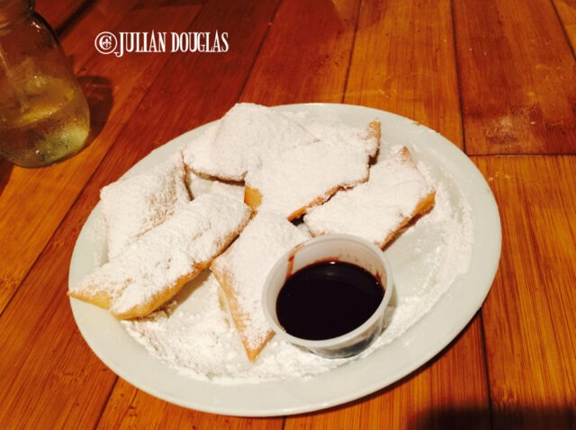 Beignets with chocolate dipping sauce.