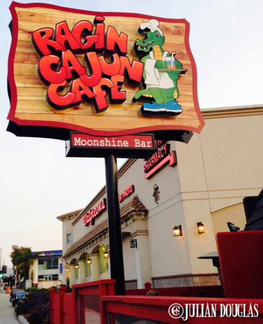 The main sign on Pacific Coast Highway pulling into the new Ragin Cajun Cafe.