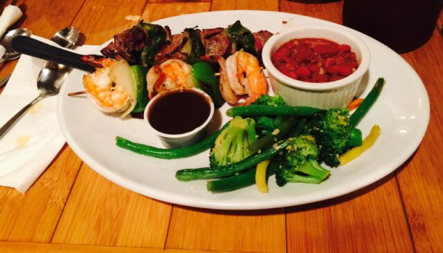 Surf & Turf ... Cajun style. BBQ Shrimp & Bacon wrapped Steak skewers.